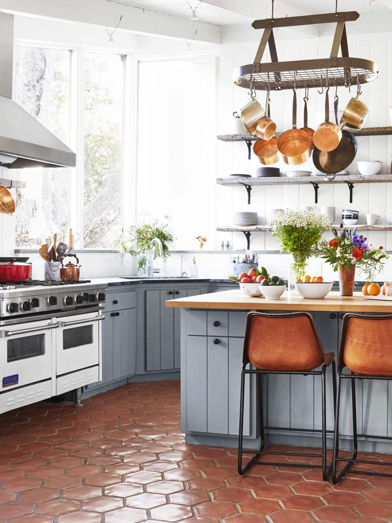 California kitchen with terracotta floor, leather stools, and gray cabinets on Thou Swell @thouswellblog