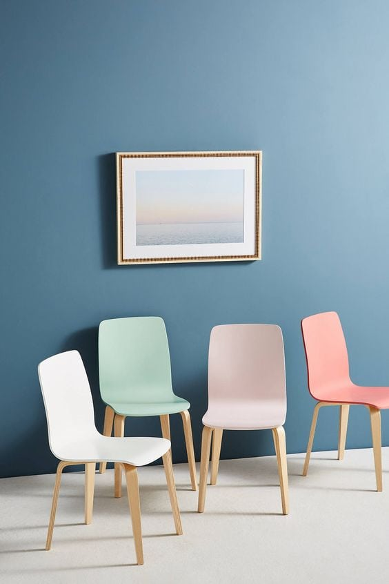 Modern pastel dining chairs against blue wall on Thou Swell @thouswellblog