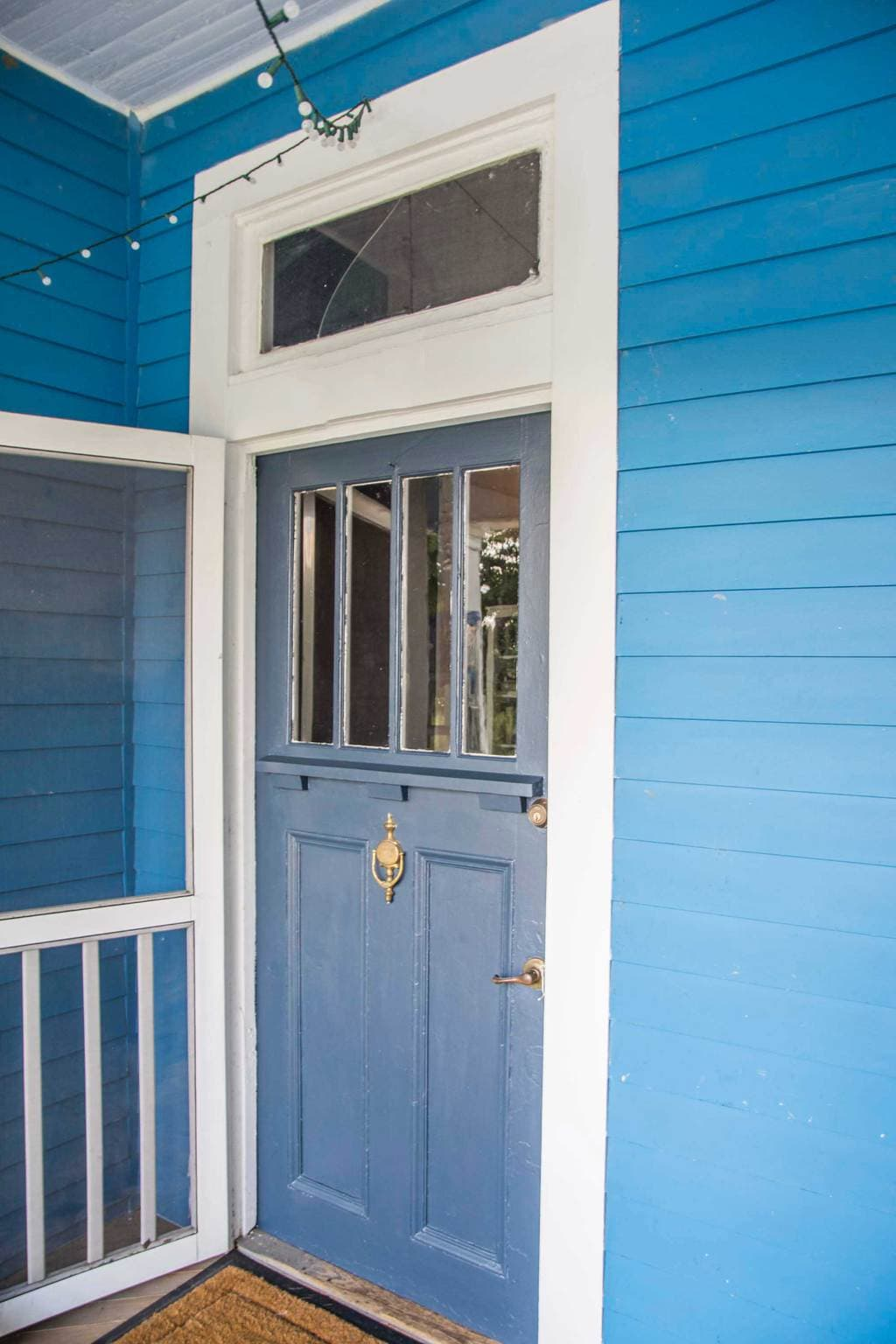 Blue home with charcoal grey front door using KILZ Complete Coat paint on Thou Swell @thouswellblog