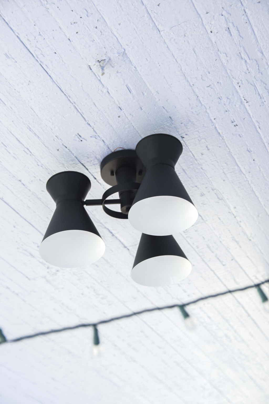 Outdoor LED light fixture on pale blue porch ceiling on Thou Swell @thouswellblog