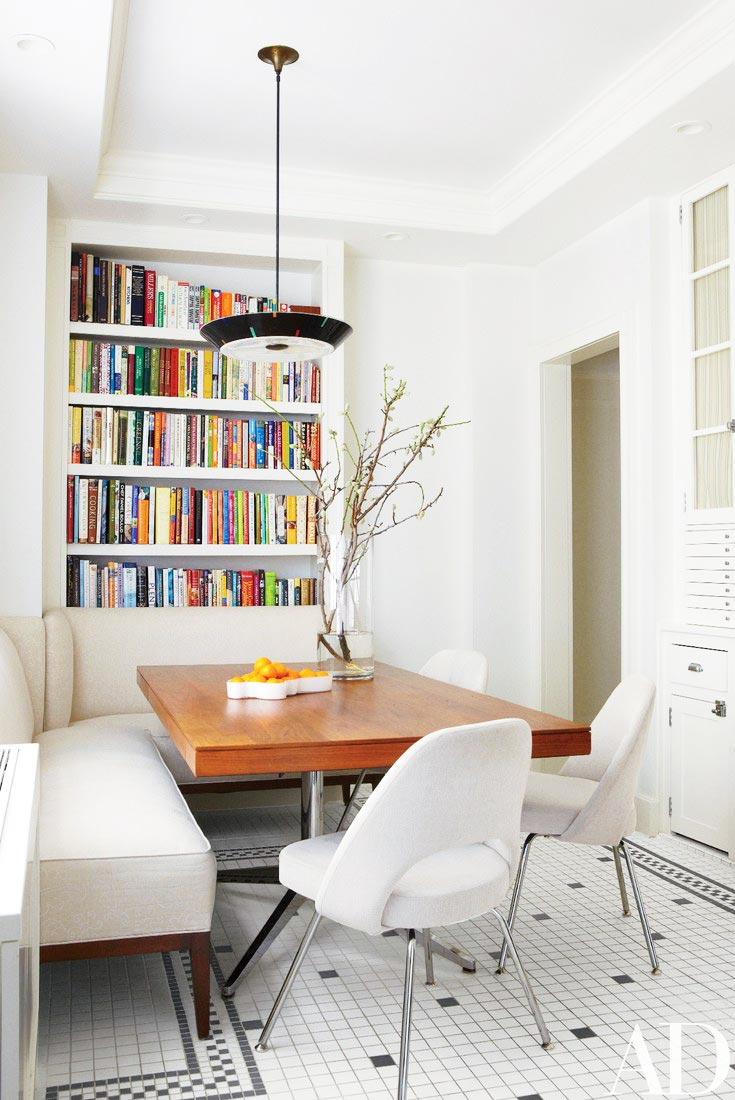 White kitchen with leather dining banquette on Thou Swell @thouswellblog