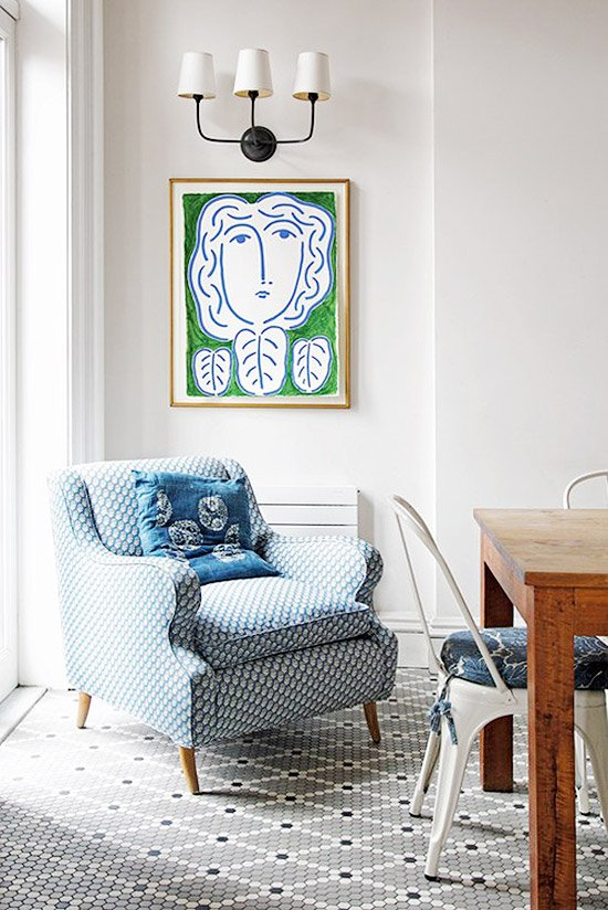 Blue pattern armchair with green painting and wall sconce on Thou Swell @thouswellblog