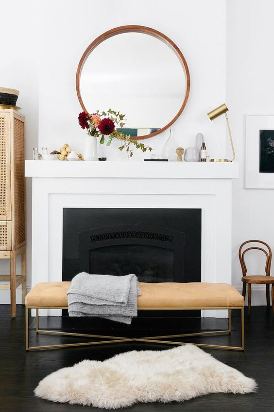 Perfect fireplace styling with leather bench and round mirror on Thou Swell @thouswellblog