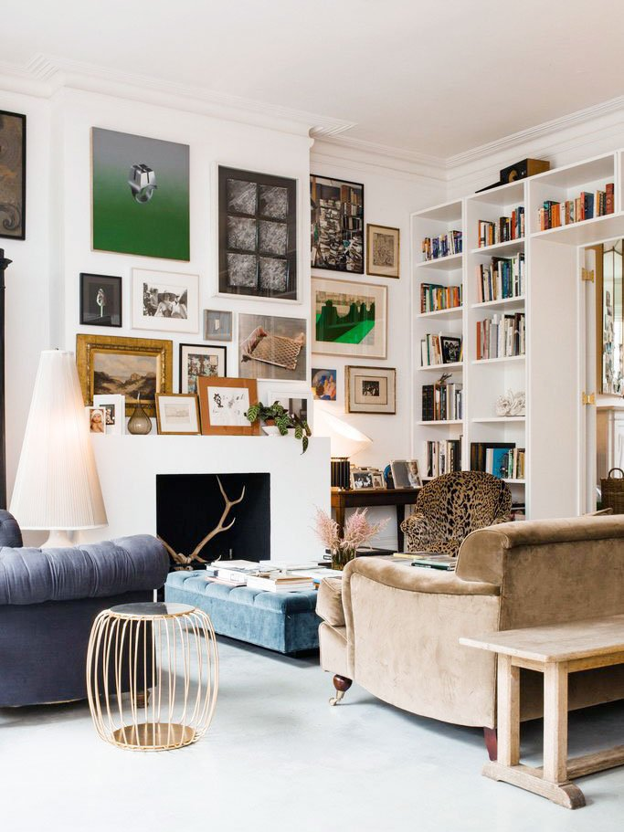 Cozy living room with lots of art and gallery walls in a modern London townhouse on Thou Swell @thouswellblog
