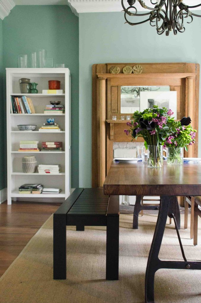 Green dining room with industrial table and dining bench on Thou Swell @thouswellblog