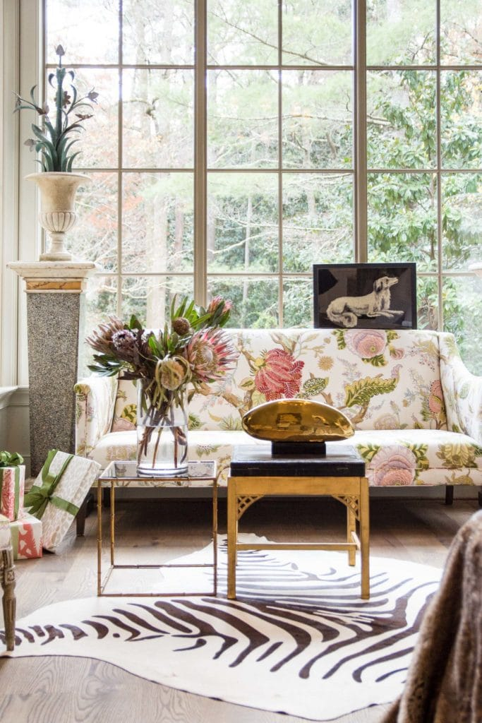 Light-filled sitting area with floor to ceiling windows and floral sofa on Thou Swell @thouswellblog