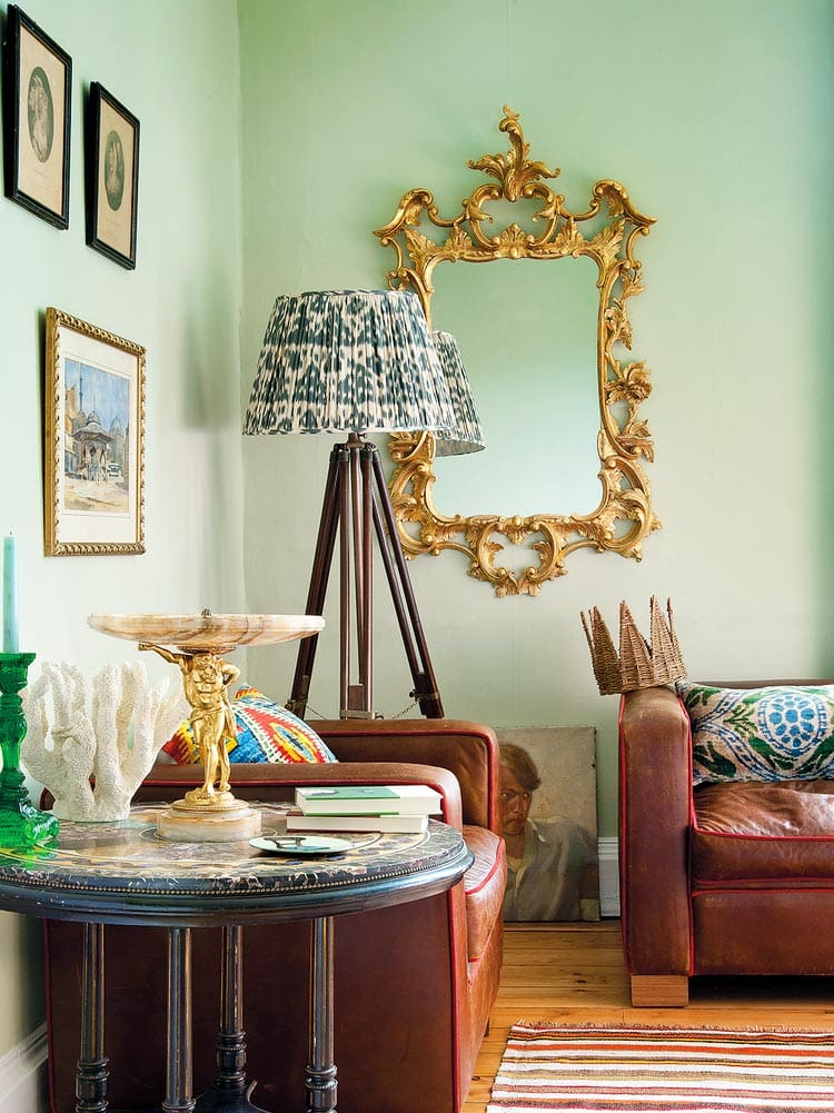 Green living room with gold mirror and tripod floor lamp with pattern lampshade on Thou Swell @thouswellblog