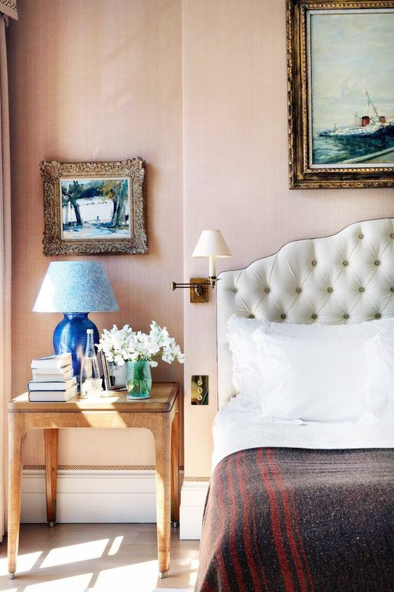 Pale pink bedroom with tufted headboard and blue lamp with pattern lampshade on Thou Swell @thouswellblog