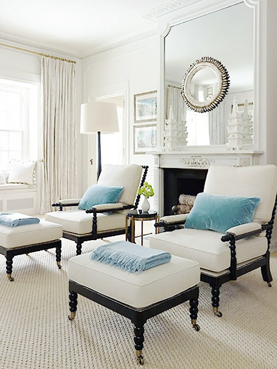 Layered mirrors above the fireplace mantel in white and blue sitting room on Thou Swell @thouswellblog
