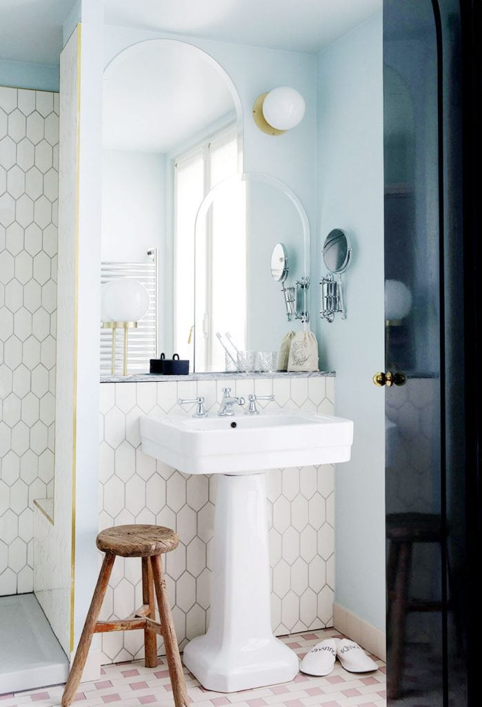 Layered mirrors in modern art-deco bathroom with light blue walls on Thou Swell @thouswellblog