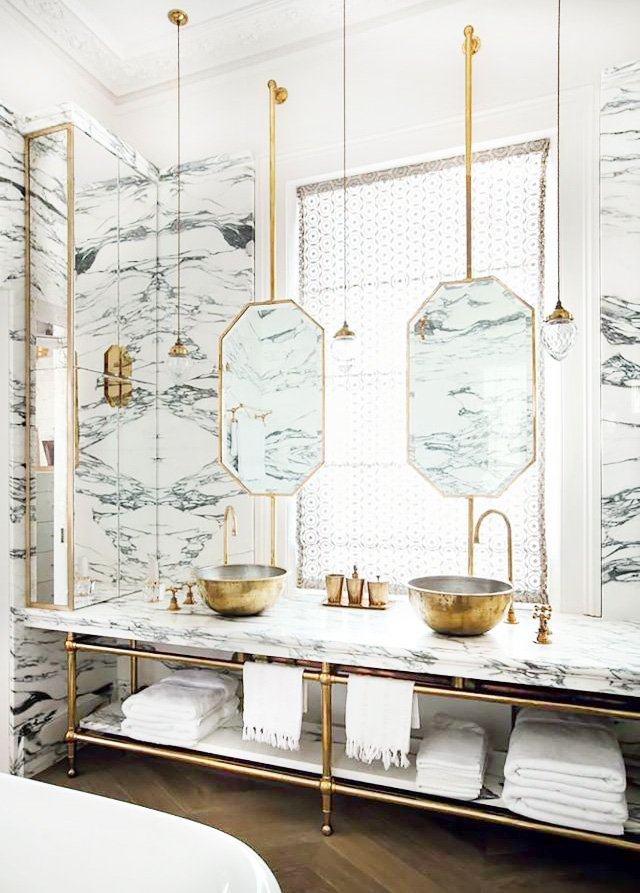 Layered mirrors in marble and brass luxury bathroom on Thou Swell @thouswellblog