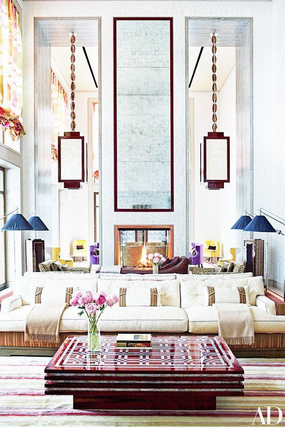 Layered mirrors in double-height living room with global bohemian style on Thou Swell @thouswellblog