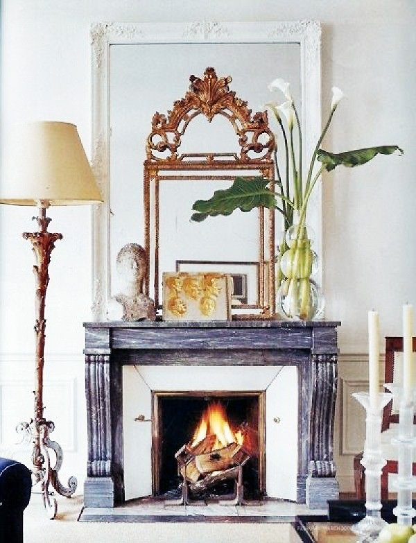 Ornate gold layered mirrors with carved fireplace mantel in classic living room on Thou Swell @thouswellblog