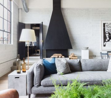 Modern D.C. loft with custom oversized chimney hood in living room on Thou Swell @thouswellblog