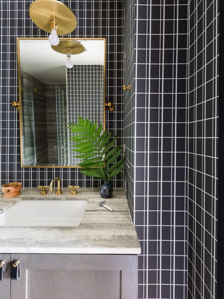 Modern bathroom with black and white grid tile and gold pendant above weathered grey vanity on Thou Swell @thouswellblog