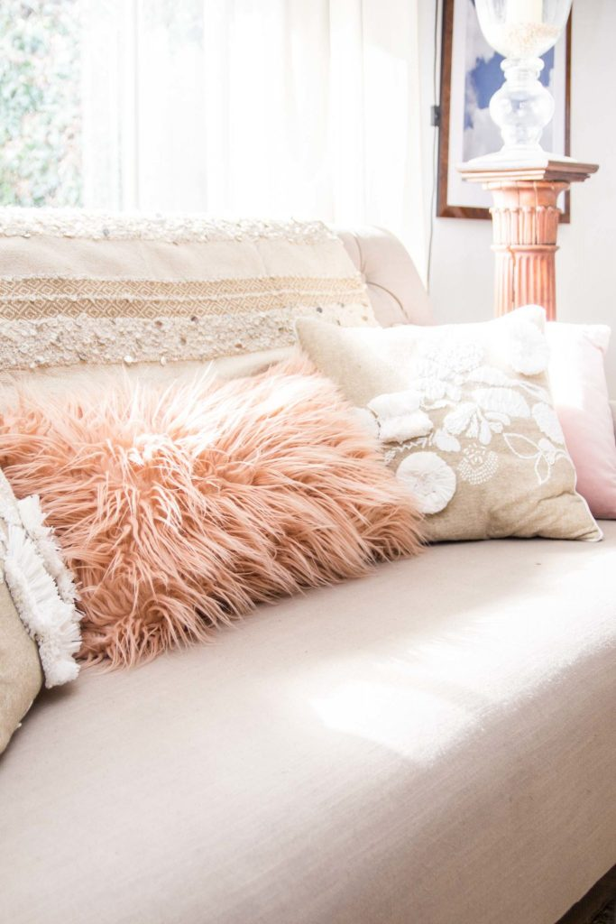 Pink, tan, and blush pillows on tan linen sofa on Thou Swell @thouswellblog