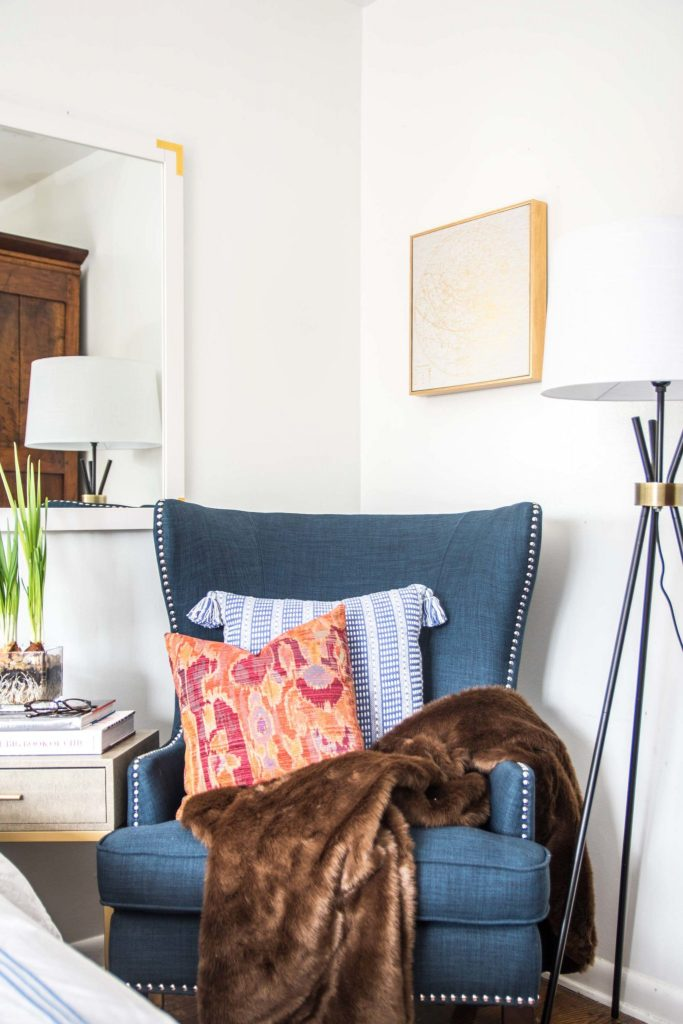 Blue wingback accent chair in a white neo-traditional bedroom on Thou Swell @thouswellblog