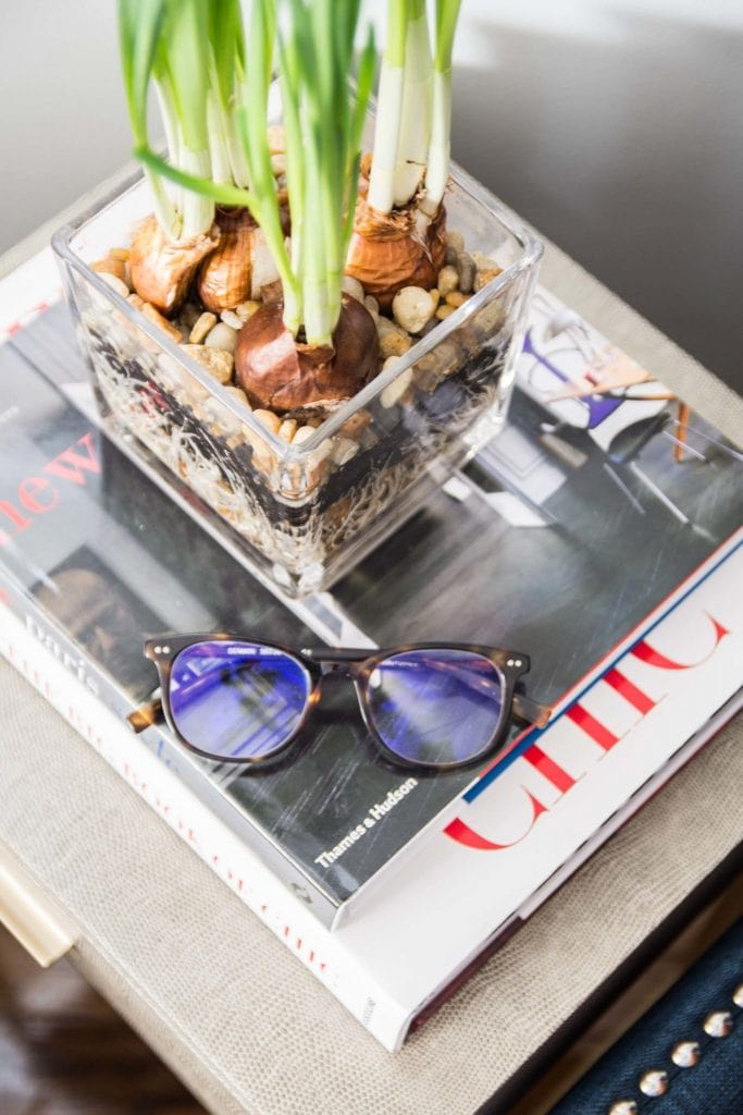 Side table details with a stack of coffee table books on Thou Swell @thouswellblog