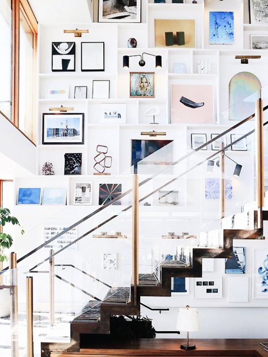 Huge gallery wall above a floating staircase in Soho House Malibu on Thou Swell @thouswellblog