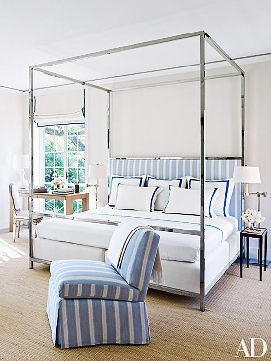 Blue and white master bedroom with chrome canopy bed in a Houston mansion on Thou Swell @thouswellblog