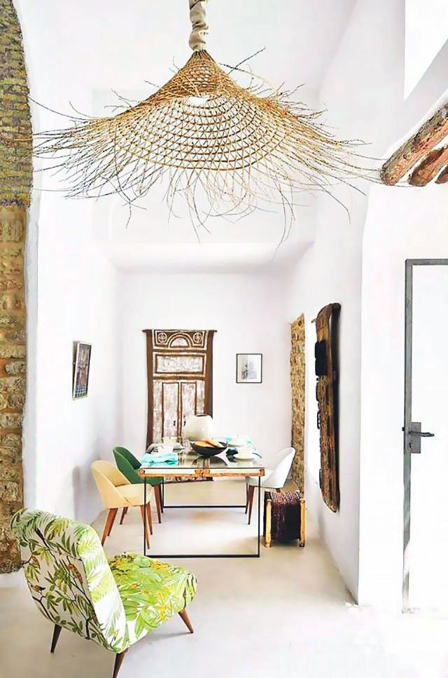 Tropical home office and dining room with oversized woven wicker pendant light and tropical print slipper chair on Thou Swell @thouswellblog