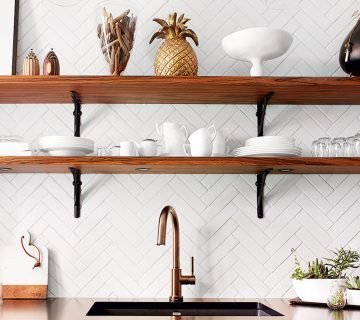 Pineapple decor in a French kitchen with blue cabinets and open shelving on Thou Swell @thouswellblog