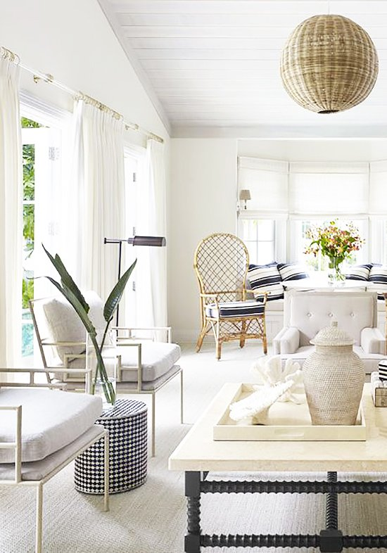 A modern take on Palm Beach style with white living room decor on Thou Swell @thouswellblog