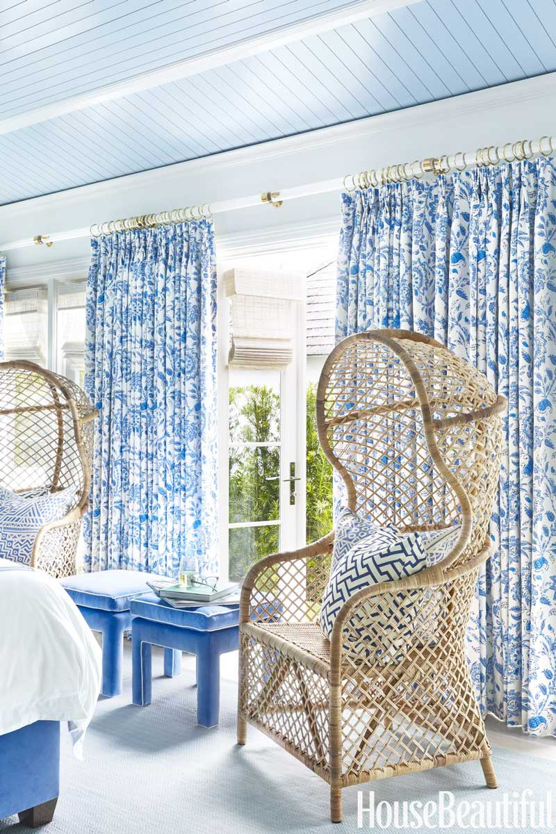 Blue and white bedroom with wicker chairs and painted ceiling on Thou Swell @thouswellblog