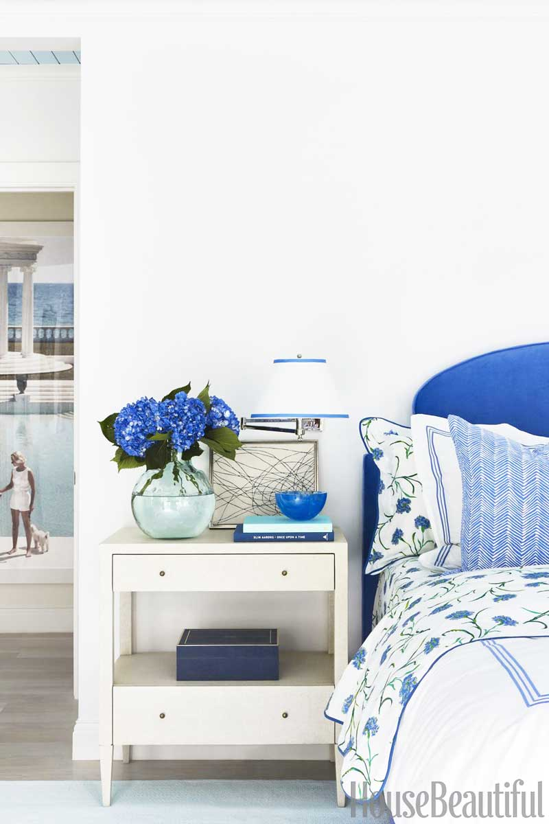 Bright blue and white bedroom with patterned bedding and Slim Aarons photograph on Thou Swell @thouswellblog