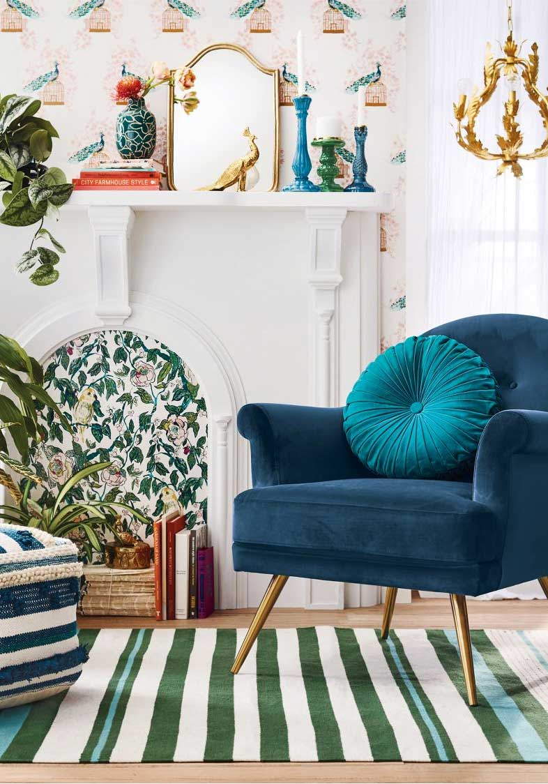 Blue velvet armchair in eclectic living room on Thou Swell @thouswellblog