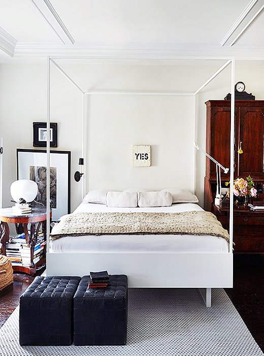 Neo-traditional bedroom with modern white canopy bed and antique secretary on Thou Swell @thouswellblog