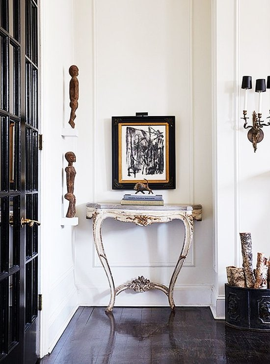 Stunning vignette with antique console table and abstract artwork in Darryl Carter home tour on Thou Swell @thouswellblog