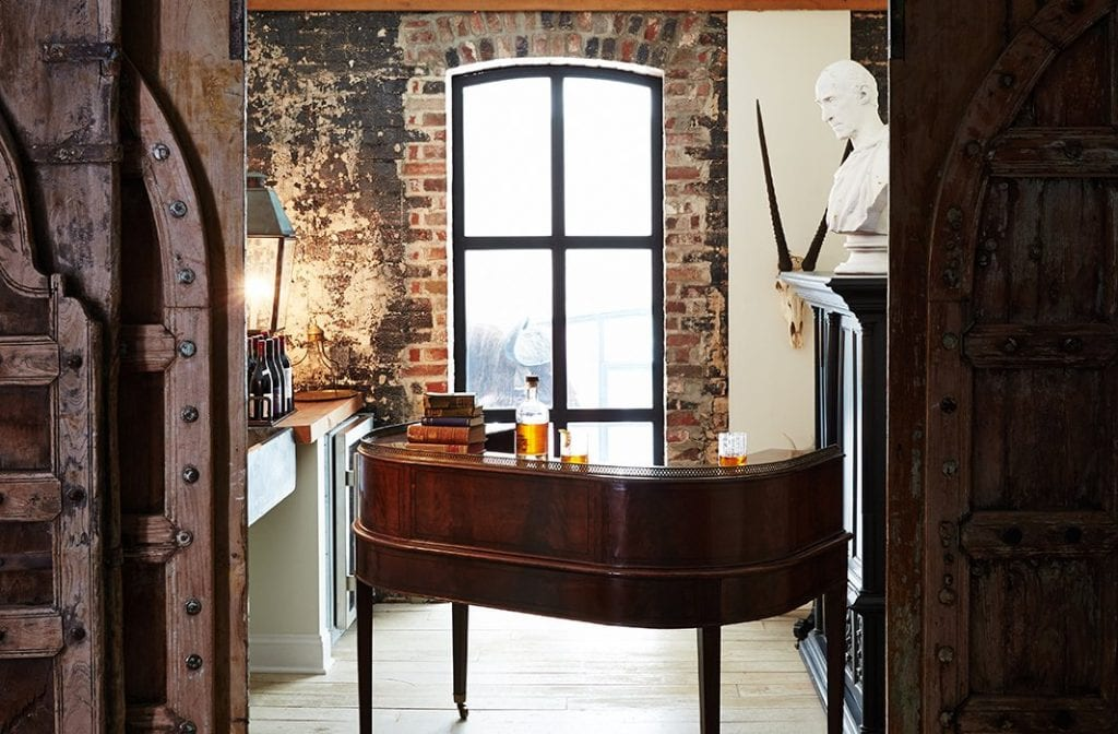 Stunning bar room with large paneled doors and brick walls on Thou Swell @thouswellblog