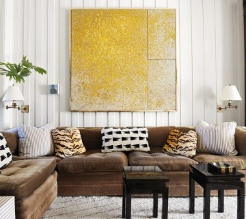 Bright family room with yellow painting and brown sectional on Thou Swell @thouswellblog