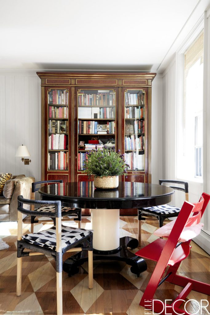 Dining room with antique cabinet, pedestal table, and IKEA dining chairs in East Village, New York City on Thou Swell @thouswellblog