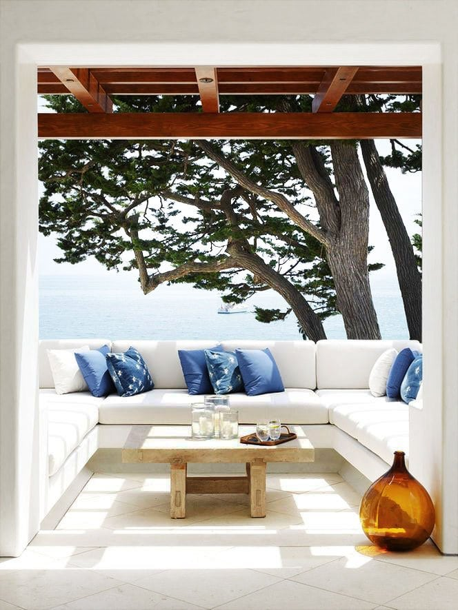 Serene balcony with white banquette on Thou Swell @thouswellblog
