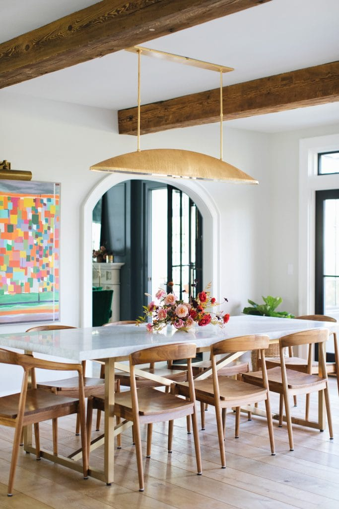 Modern dining room with gold pendant light by Kelly Wearstler on Thou Swell @thouswellblog