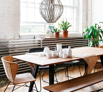 Industrial loft dining room with dining benches and rattan chairs on Thou Swell @thouswellblog