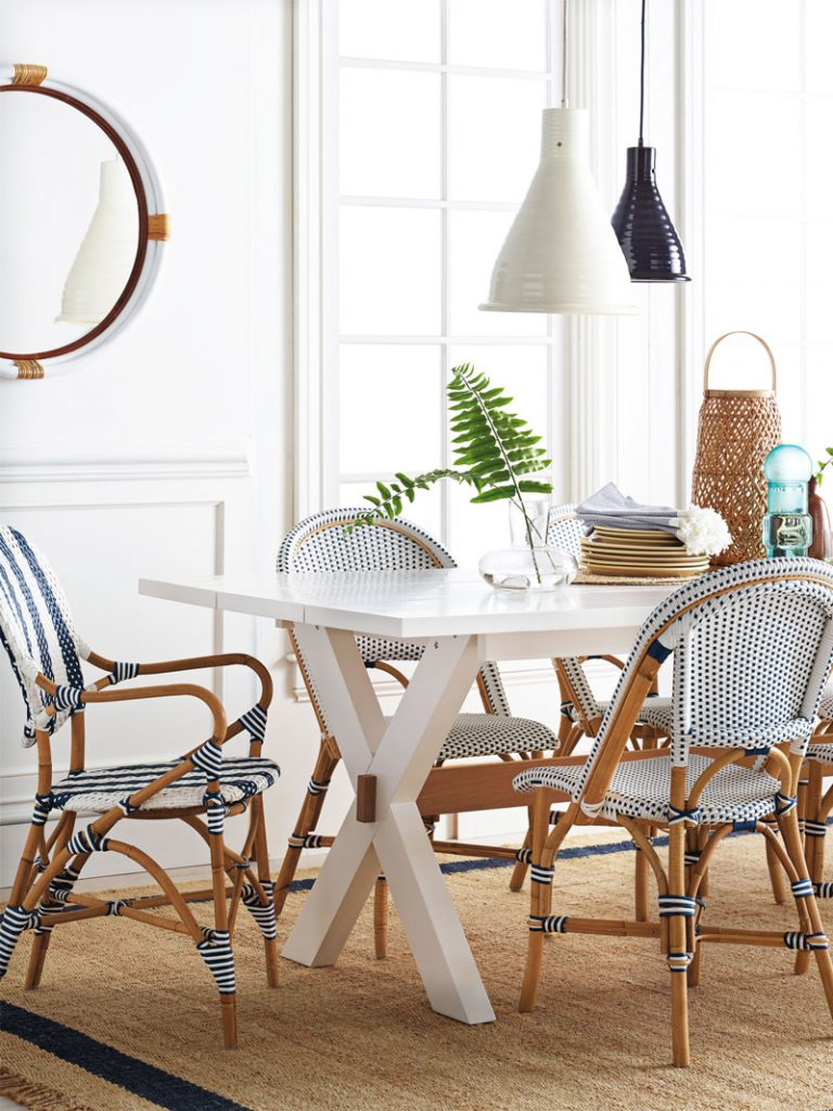 Coastal dining room with Riviera woven cafe chairs in blue and white on Thou Swell @thouswellblog