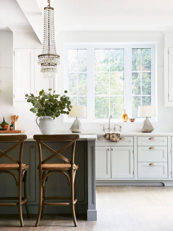 Rustic chic kitchen with crystal chandelier and table lamps beside the sink on Thou Swell @thouswellblog