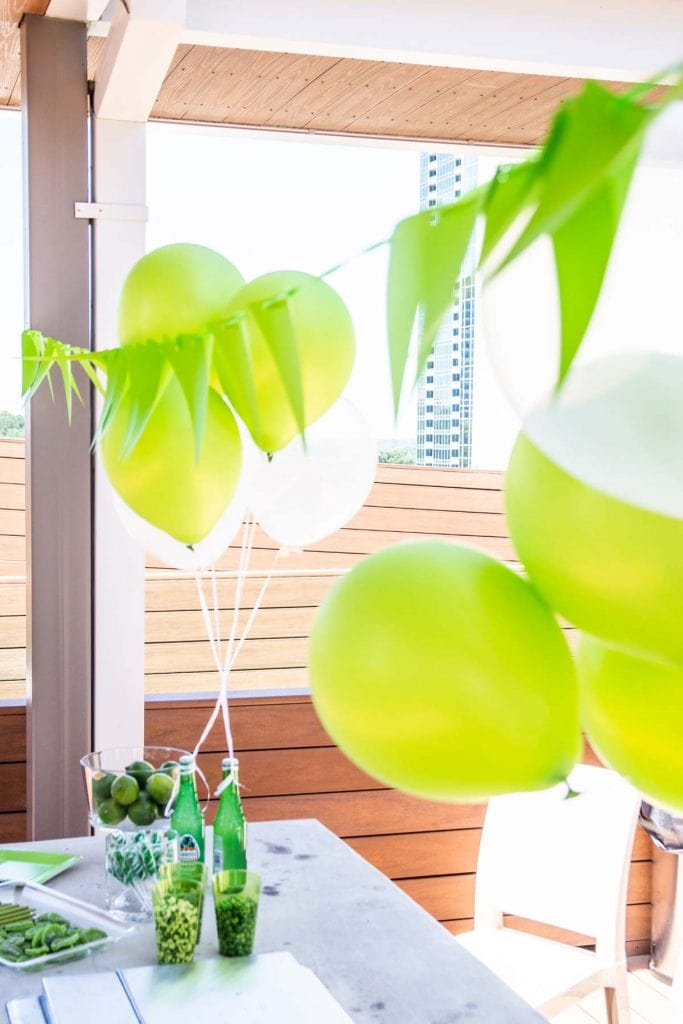 Green and white bubbly birthday party with Balloon Time helium tank on Thou Swell @thouswellblog