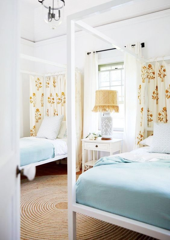 Light, coastal twin bedroom with canopy beds in the Bahamas on Thou Swell @thouswellblog