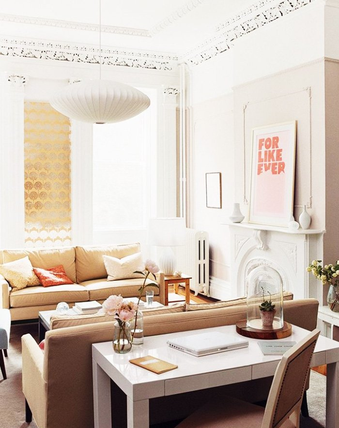 Neutral living room with pink print above fireplace on Thou Swell @thouswellblog