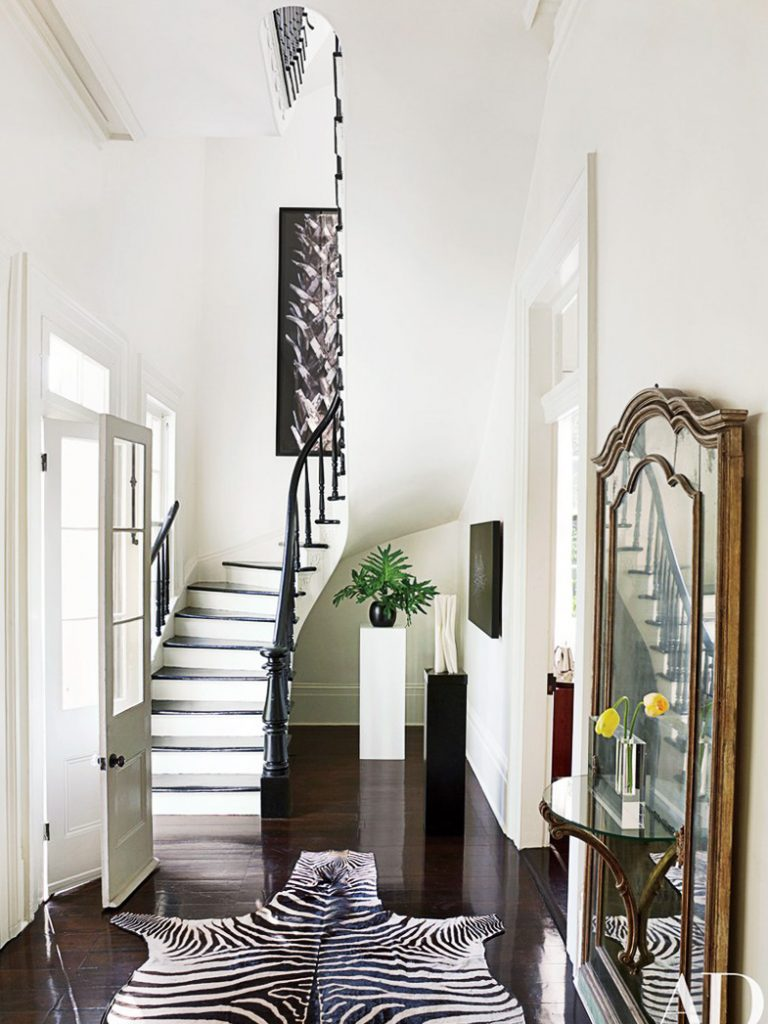 Traditional entryway in New Orleans with gold mirror and zebra rug on Thou Swell @thouswellblog