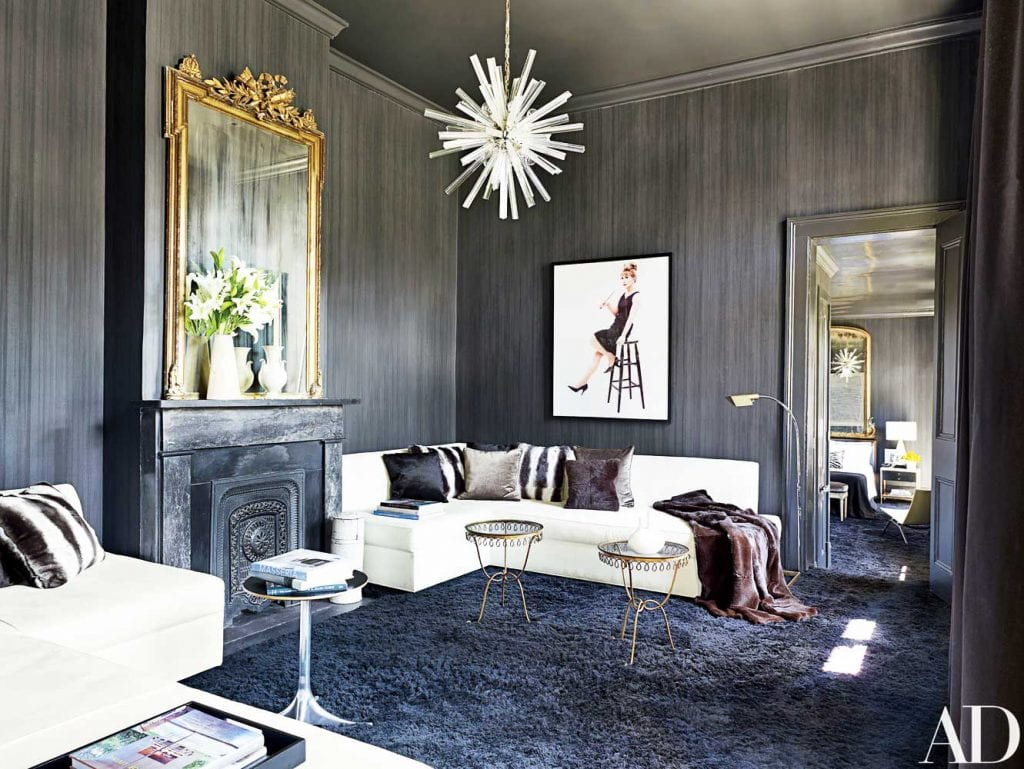 Fabulous grey bedroom in New Orleans with lucite chandelier and gold mirror on Thou Swell @thouswellblog