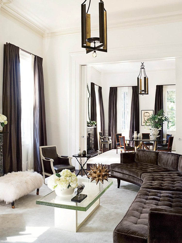 Chic brown and white living room in New Orleans with curved sectional on Thou Swell @thouswellblog