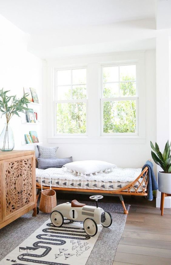 Modern kids bedroom with rattan daybed on Thou Swell @thouswellblog