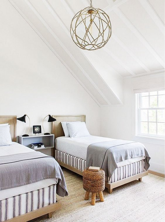 Simple white kids bedroom with twin beds and striped box springs on Thou Swell @thouswellblog