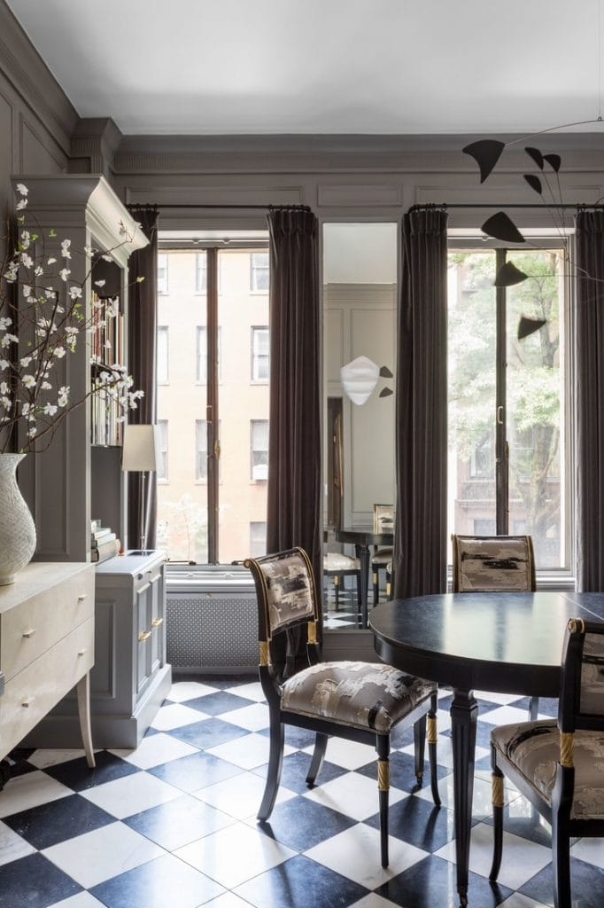 Beautiful black and white marble checkerboard floor in Ryan Korban townhouse dining room on Thou Swell @thouswellblog