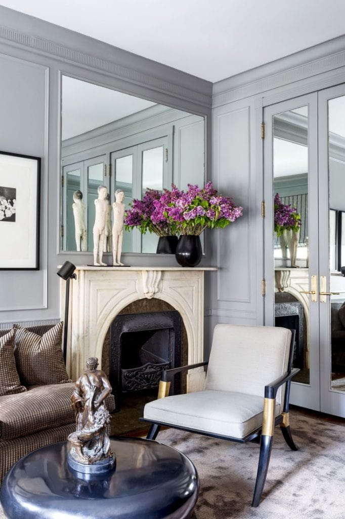 Gorgeous grey mirrored sitting room with marble fireplace and velvet sofa on Thou Swell @thouswellblog